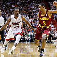 24 January 2012: Miami Heat point guard Norris Cole (30) drives past Cleveland Cavaliers point guard Ramon Sessions (3) during the Miami Heat 92-85 victory over the Cleveland Cavaliers at the AmericanAirlines Arena, Miami, Florida, USA.