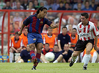 12 August 2003; Ronaldinho De Asis, Barcelona, in action against Derry City's Eddie McCallion. Friendly game, Derry City v Barcelona, Brandywell, Derry. Picture credit; David Maher / SPORTSFILE *EDI*