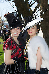 LIVERPOOL, ENGLAND, Friday, April 8, 2011: Mother and daughter Lay and Mimi (R) during Ladies' Day on Day Two of the Aintree Grand National Festival at Aintree Racecourse. (Photo by David Rawcliffe/Propaganda)