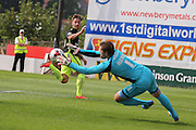Exeter goalkeeper Bobby Olejnik saves from forward Jake Hyde during the Sky Bet League 2 match between Exeter City and York City at St James' Park, Exeter, England on 22 August 2015. Photo by Simon Davies.