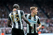 Newcastle United midfielder Mohamed Diame (#15) celebrates his assist with Newcastle United midfielder Matt Ritchie (#11) for the opening Newcastle United goal (1-0) scored by Newcastle United forward Dwight Gayle (#9) during the EFL Sky Bet Championship match between Newcastle United and Wigan Athletic at St. James's Park, Newcastle, England on 1 April 2017. Photo by Craig Doyle.