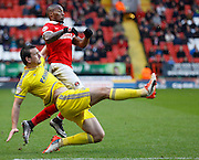 Nottingham Forest defender Jack Hobbs clears in style while being pressured by Charlton Athletic midfielder Callum Harriott during the Sky Bet Championship match between Charlton Athletic and Nottingham Forest at The Valley, London, England on 2 January 2016. Photo by Andy Walter.