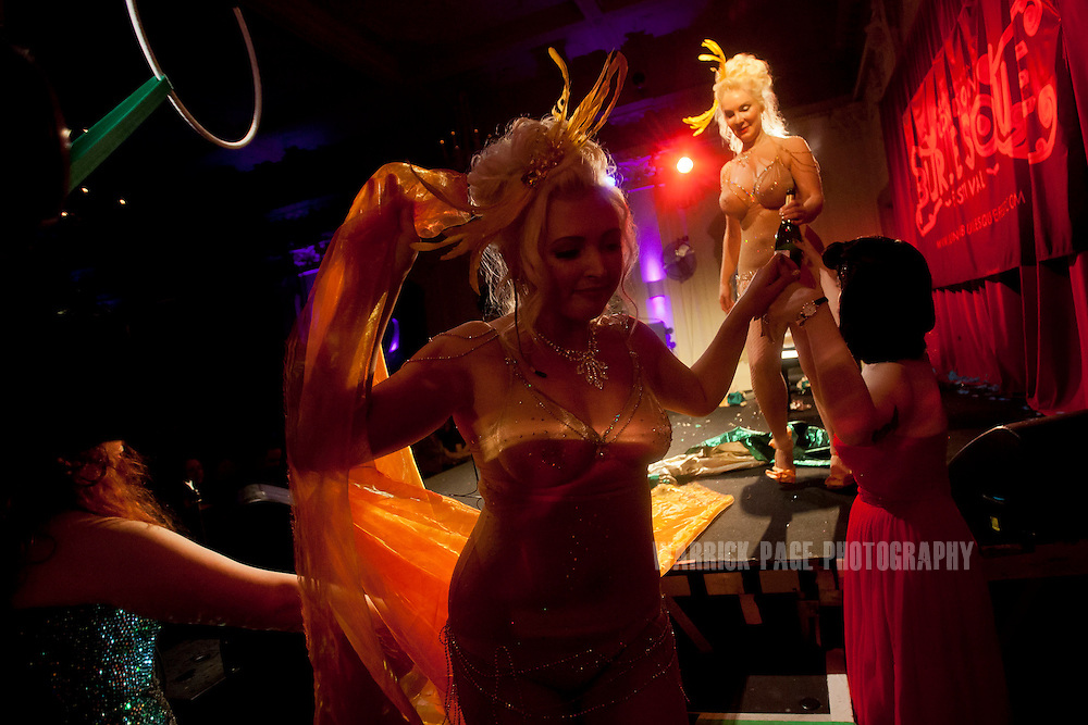 Burlesque artists leave the stage after their routine at the London Burlesque Festival, May 11, 2013, in London, England. (Photo by Warrick Page)