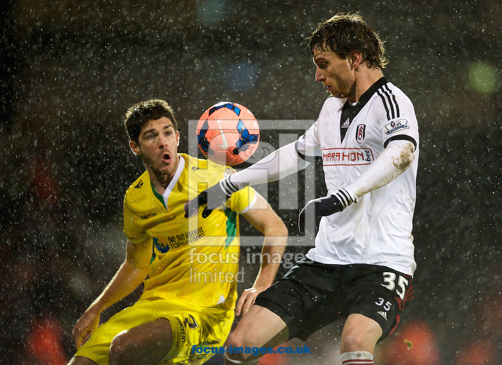 Picture by Alan Stanford/Focus Images Ltd +44 7915 056117<br /> 04/02/2014<br /> Fernando Amorebieta of Fulham shows good ball control while Ryan Flynnof Sheffield United looks on during the The FA Cup match at Craven Cottage, London