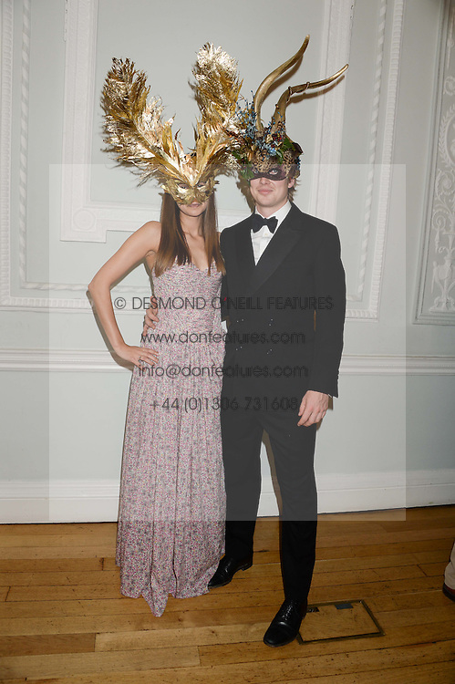 CARLY VINCENT and GEORGE BUTLER at the The Animal Ball – Masking Up Moment held at the Quintessentially Ballrooms, 29 Portland Place, London W1 on 10th June 2013.