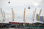 The Emirates Air Line cable car over the the River Thames during testing on June 18, 2012 in London, England. The new cable car which will carry passengers over the river from the O2 Arena at Greenwich to The ExCel Centre will take 5 minutes and cost £50 million to construct. It opens to the public on June 28, 2012. .Photo Ki Price