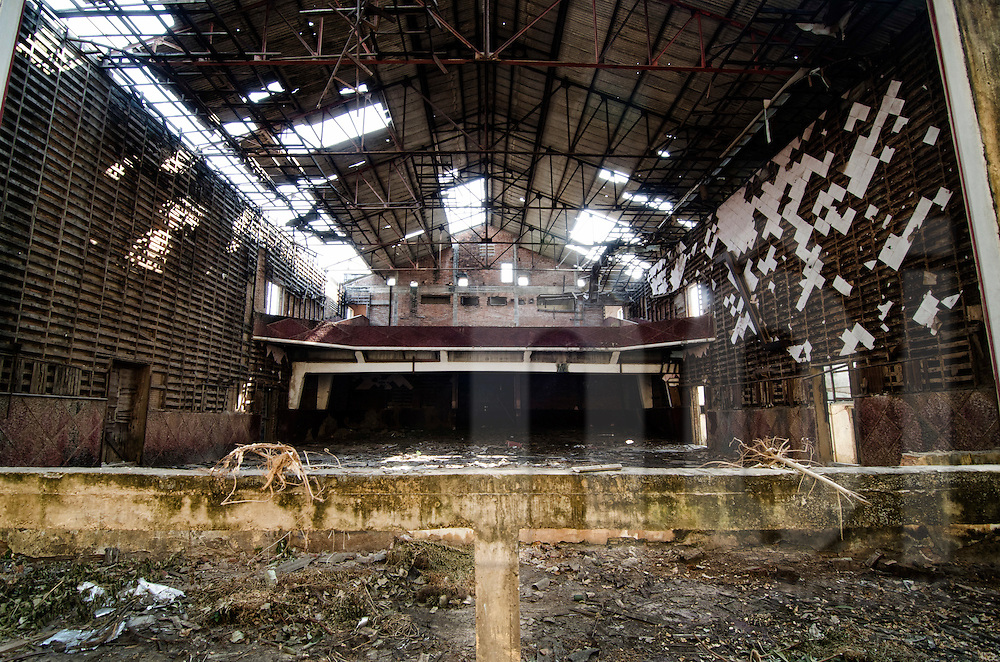 Abandoned Sengchaleun cinema, Savannakhet, Laos, Asia. Interiors are in complete decay and very messy. Roof structure is rusty