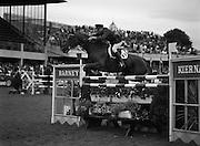 "08/08/1987<br /> 08/08/1987<br /> 08 August 1987<br /> RDS Horse Show, Ballsbridge, Dublin. The Irish Trophy - Grand Prix of Ireland. Commandant Gerry Mullins on ""Rockbarton""."