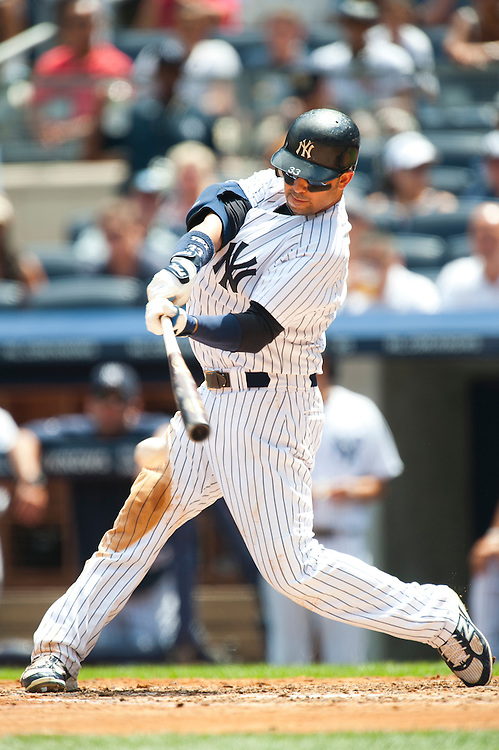 NEW YORK - JULY 27: Nick Swisher #33 of the New York Yankees bats during the game against the Seattle Mariners at Yankee Stadium on July 27, 2011 in the Bronx borough of Manhattan. (Photo by Rob Tringali) *** Local Caption *** Nick Swisher
