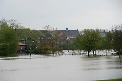 © London News Pictures. 01/05/2012. Tewkesbury, UK. Fields covered in flood water close to houses in Tewkesbury, Gloucestershire, England on May 1, 2012. The UK has had its wettest April in over a century, with some areas seeing three times their usual average rainfall, according to figures from the Met Office. Photo credit : Ben Cawthra /LNP