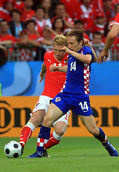 Luka Modric of Croatia (R) and Ronald Gercaliu of Austria during the UEFA EURO 2008 Group B soccer match between Austria and Croatia at Ernst-Happel Stadium, on June 8,2008, in Vienna, Austria.  (Photo by Vid Ponikvar / Sportal Images)