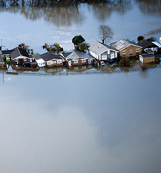© London News Pictures. 09/02/2014. Shepperton, UK.  Aerial view showing flooding covering properties in Shepperton, Surrey. The Thames river has hit record levels causing extensive flooding to parts of the southeast of England. Photo credit : Ben Cawthra/LNP