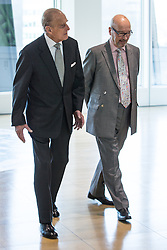 © Licensed to London News Pictures . FILE PICTURE DATED 14/11/2013 . Manchester , UK . LEN WARDLE (right in glasses) with the Prince Philip the Duke of Edinburgh at the Co-operative's new corporate HQ at 1 Angel Square . The chairman of the Co-operative Group , Len Wardle , has resigned after a sex and drugs scandal involving the group's former banking chairman , Paul Flowers . Queen Elizabeth II and the Duke of Edinburgh visit the Coop building at 1 Angel Square , Manchester , this morning ( 14th November 2013 ) . Photo credit : Joel Goodman/LNP