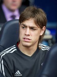 LONDON, ENGLAND - Sunday, September 18, 2011: Liverpool's substitute Sebastian Coates sits on the bench before the Premiership match against Tottenham Hotspur at White Hart Lane. (Pic by David Rawcliffe/Propaganda)