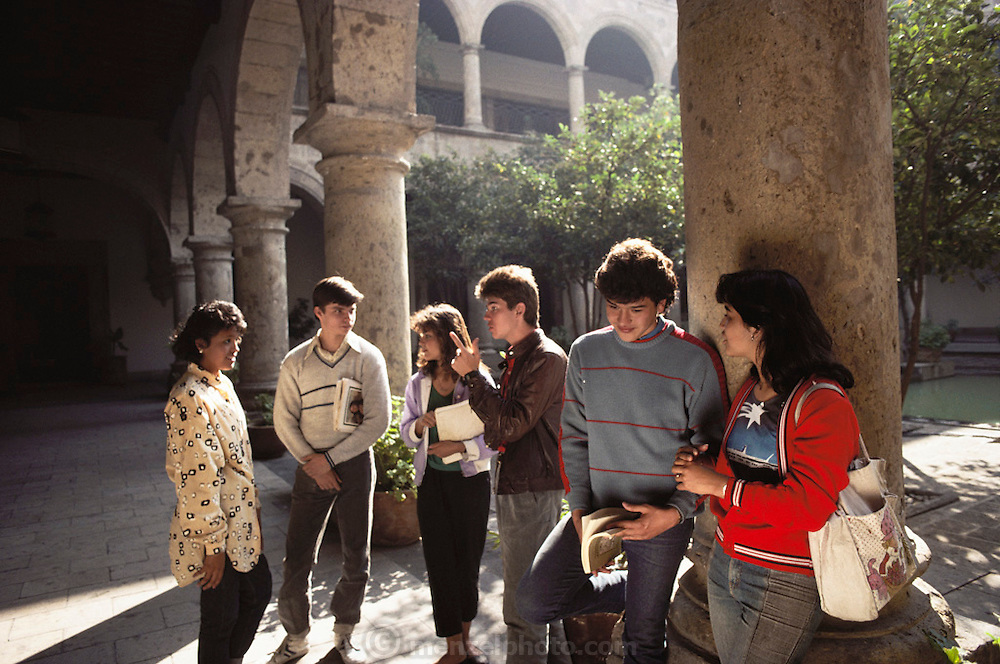 Students at the interior patio courtyard of the University of Guadalajara, Mexico.