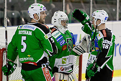 Jean-Philippe Lamoureux (HDD Tilia Olimpija, #1), Ken Ograjensek (HDD Tilia Olimpija, #18) and Scott Hotham (HDD Tilia Olimpija, #5) celebrate victory during ice-hockey match between HDD Tilia Olimpija and EC Red Bull Salzburg in 48th Round of EBEL league, on January 29, 2012 at Hala Tivoli, Ljubljana, Slovenia. (Photo By Matic Klansek Velej / Sportida)