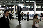 office people walking to and from Shinagawa station Tokyo