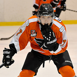 WHITBY, ON - Feb 11: Ontario Junior Hockey League game between Orangeville Flyers and Whitby Fury. Colin Rigney #7 of the Orangeville Flyers Hockey Club during first period game action.<br /> (Photo by Shawn Muir / OJHL Images)