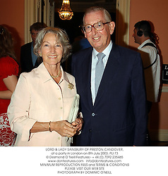 LORD & LADY SAINSBURY OF PRESTON CANDOVER, at a party in London on 8th July 2003.PLI 73