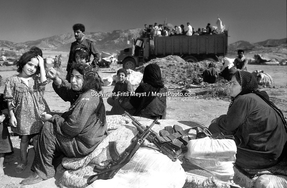 PASHMAQ, KURDISTAN, NORTHERN IRAQ, 10.09.96.  Kurdish and arab refugees belonging to the PUK and the INC gather at the border with Iran, on the run foir the KDP and Iraqi forces. ©Photo by Frits Meyst/ILLUSTRIOUS.<br /><br />kurdistan, kurds, middle east, politics, war, battle, combat, conflicts, civil war, kurdistan Democratic party, guerilla's. patriotic union of kurdistan, iraqi national congress, refugees