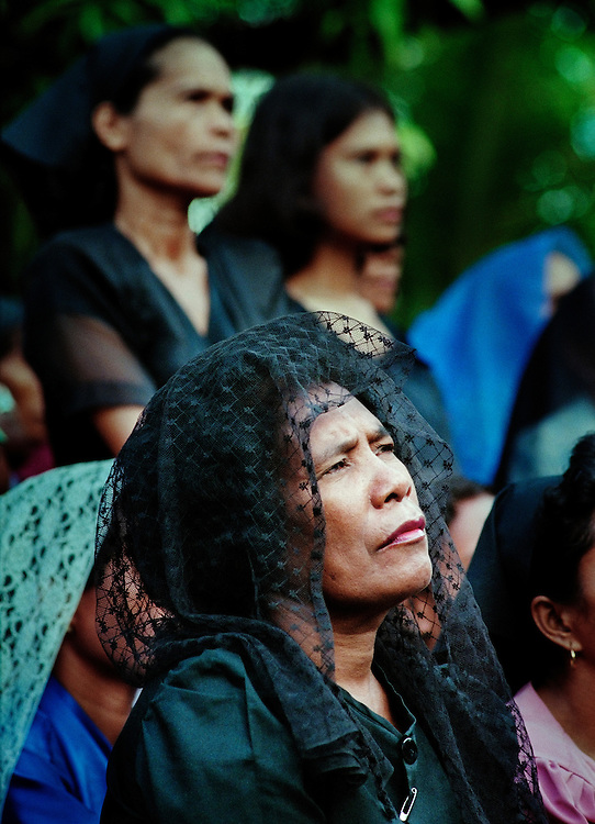 East Timorese listening to a service by Bishop Carlos Felipe Ximenes Belo, at his residence in Dili on Easter Sunday 1999.