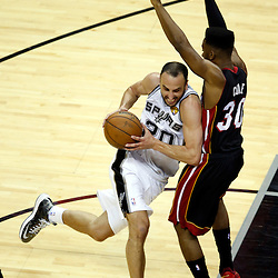 Jun 16, 2013; San Antonio, TX, USA; San Antonio Spurs shooting guard Manu Ginobili (20) drives against Miami Heat point guard Norris Cole (30) during the third quarter of game five in the 2013 NBA Finals at the AT&T Center. Mandatory Credit: Derick E. Hingle-USA TODAY Sports