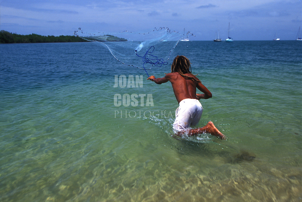 BELIZE / Placencia / Man fishing at the beach...© JOAN COSTA