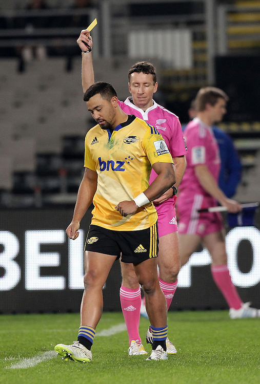 Hurricanes' Matt Proctor is shown a yellow card by referee Garratt Williamson whilst playing the Blues in a Super Rugby match, Eden Park, Auckland, New Zealand, Saturday, May 31, 2014.  Credit:SNPA / David Rowland