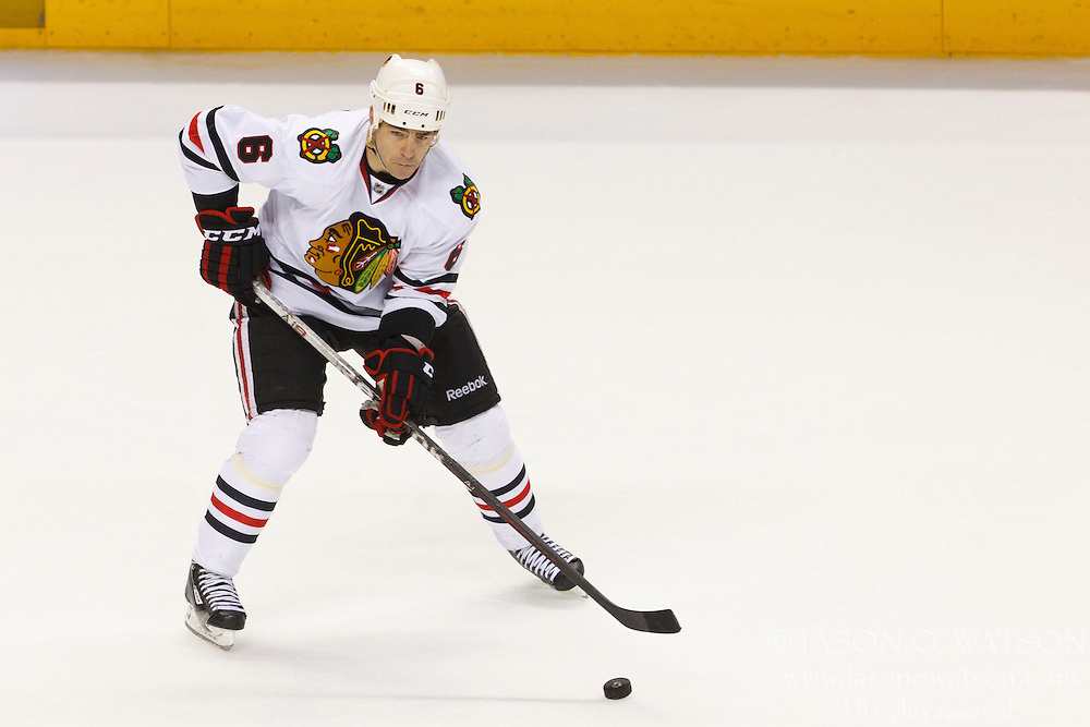 Feb 10, 2012; San Jose, CA, USA; Chicago Blackhawks defenseman Sean O'Donnell (6) skates with the puck against the San Jose Sharks during the third period at HP Pavilion. San Jose defeated Chicago 5-3. Mandatory Credit: Jason O. Watson-US PRESSWIRE