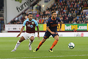 29 Kerim Frei for İstanbul Başakşehir F.K.and 25 Aaron Lennon for Burnley FC during the Europa League third qualifying round leg 2 of 2 match between Burnley and Istanbul basaksehir at Turf Moor, Burnley, England on 16 August 2018.