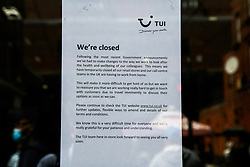 © Licensed to London News Pictures. 30/07/2020. London, UK. A notice on a window of Tui store on Wood Green High Road in north London. Tui stores have been closed since last March following the outbreak of COVID-19. Tour operator Tui announced that 166 high street stores in the UK and the Republic of Ireland will shut due to a downturn in travel caused by the coronavirus pandemic. Photo credit: Dinendra Haria/LNP