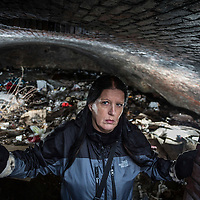 29/01/16 Salford - Angela Penny Barratt who works for Street Support Salford pictured firstly by rrailway arches that are used by homeless people and  in the Cave a former railway arch under the now demolished Victoria Station which is used by homeless people to sleep in.
