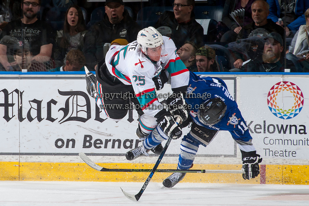 KELOWNA, CANADA - APRIL 14: Cal Foote #25 of Kelowna Rockets checks Matthew Phillips #11 of Victoria Royals during the third period on April 14, 2016 at Prospera Place in Kelowna, British Columbia, Canada.  (Photo by Marissa Baecker/Shoot the Breeze)  *** Local Caption *** Cal Foote; Matthew Phillips;