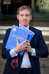 © Licensed to London News Pictures. 29/11/2012. London, UK. Labour MP Chris Bryant holds up a copy of the Leveson Inquiry Report, which consists of four books, for photographers outside the Queen Elizabeth Conference Centre in London today (29/11/12) after hearing the results of Lord Leveson's inquiry into the British media. Photo credit: Matt Cetti-Roberts/LNP