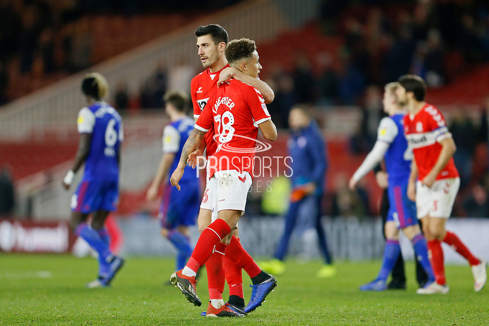 Middlesbrough defender Danny Baath (6) and Middlesbrough midfielder Marcus Tavernier (28) embrace at full time during the EFL Sky Bet Championship match between Middlesbrough and Ipswich Town at the Riverside Stadium, Middlesbrough, England on 29 December 2018.