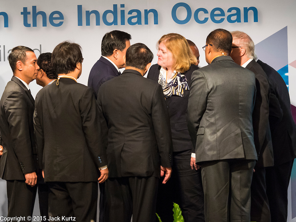 """29 MAY 2015 - BANGKOK, THAILAND: Participants in the """"Special Meeting on Irregular Migration in the Indian Ocean"""" gather around ANNE CLAIRE RICHARD, the US Assistant Secretary of State for Population, Refugees, and Migration Affairs, at the opening of the meeting. Thailand organized and hosted the meeting at the Anantara Siam Hotel in Bangkok. The meeting brought together representatives from the 5 countries impacted by the boat people exodus: Thailand, Malaysia and Indonesia, which have all received boat people, and Myanmar (Burma) and Bangladesh, where they are coming from. Non-governmental organizations, like the International Organization for Migration (IOM) and UN High Commissioner for Refugees (UNHCR) as well as countries responding to the crisis, like the United States, also attended the meeting. A total of 22 organizations attended the one day conference.      PHOTO BY JACK KURTZ"""