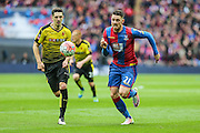 Crystal Palace's Connor Wickham and Watford's Craig Cathcart race for the ball during the The FA Cup match between Crystal Palace and Watford at Wembley Stadium, London, England on 24 April 2016. Photo by Shane Healey.