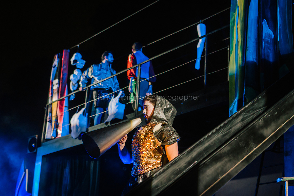 ROME, ITALY - 27 JUNE 2017: A scene of the &quot;Don Giovanni OperaCamion&quot;, an open-air opera performed on a truck in San Basilio, a suburb in Rome, Italy, on June 27th 2017.<br /> <br /> Director Fabio Cherstich&rsquo;s idae of an &ldquo;opera truck&rdquo; was conceived as a way of bringing the musical theatre to a new, mixed, non elitist public, and have it perceived as a moment of cultural sharing, intelligent entertainment and no longer as an inaccessible and costly event. The truck becomes a stage that goes from square to square with its orchestra and its company of singers in Rome. <br /> <br /> &ldquo;Don Giovanni Opera Camion&rdquo;, after &ldquo;Don Giovanni&rdquo; by Wolfgang Amadeus Mozart is a new production by the Teatro dell&rsquo;Opera di Roma, conceived and directed by Fabio Cherstich. Set, videos and costumes by Gianluigi Toccafondo. The Youth Orchestra of the Teatro dell&rsquo;Opera di Roma is conducted by Carlo Donadio.
