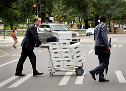 01 June  2015. New Orleans, Louisiana. <br /> Boxes of legal files leave the New Orleans Civil District Court at the end of the 1st day's hearing into the competency of Tom Benson.  Benson is the billionaire owner of the NFL New Orleans Saints, the NBA New Orleans Pelicans, various auto dealerships, banks, property assets and a slew of business interests. His competency to run his business empire is being challenged by family members after Benson changed his succession plans and decided to leave the bulk of his estate to third wife Gayle, sparking a controversial legal battle.<br /> Photo©; Charlie Varley/varleypix.com