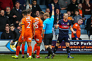 Doncaster Rovers defender Aaron Lewis (44) receives a yellow card for his tackle on Luton Town forward Kazenga LuaLua (25) during the EFL Sky Bet League 1 match between Luton Town and Doncaster Rovers at Kenilworth Road, Luton, England on 23 March 2019.