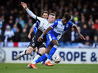 Football - 2019 / 2020 Emirates FA Cup - Third Round: Bristol Rovers vs. Coventry City<br /> <br /> Bristol Rovers' Rollin Menayese holds off the challenge from Coventry City's Jordan Shipley, at the Memorial Stadium.<br /> <br /> COLORSPORT/ASHLEY WESTERN
