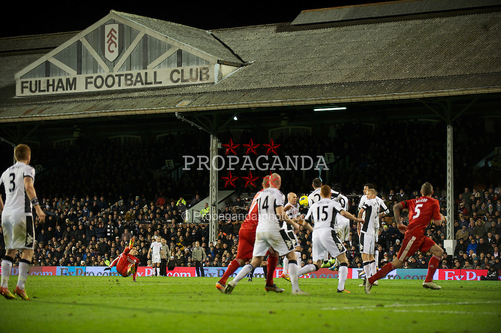 LONDON, ENGLAND - Monday, December 5, 2011: Liverpool's Luis Alberto Suarez Diaz sees his free-kick hit the Fulham wall during the Premiership match at Craven Cottage. (Pic by David Rawcliffe/Propaganda)