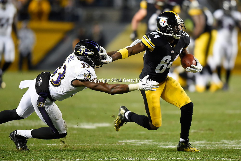 PITTSBURGH, PA - NOVEMBER 02:  Antonio Brown #84 of the Pittsburgh Steelers breaks a tackle by Will Hill #33 of the Baltimore Ravens and scores a 54 yard touchdown during the fourth quarter at Heinz Field on November 2, 2014 in Pittsburgh, Pennsylvania.  (Photo by Joe Sargent/Getty Images) *** Local Caption ***