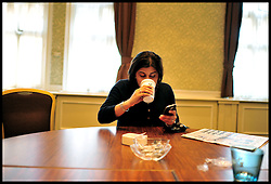 Co-Chairman of the Conservative Party Sayeeda Warsi checks get phone in the Green Room as she tour's the country attending meet the Chairman event, Wednesday September 1, 2010, Photo By Andrew Parsons/i-Images