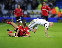 Cardiff City's Ben Turner tackles Swansea City's Jonjo Shelvey - Photo mandatory by-line: Joe Meredith/JMP - Tel: Mobile: 07966 386802 03/11/2013 - SPORT - FOOTBALL - The Cardiff City Stadium - Cardiff - Cardiff City v Swansea City - Barclays Premier League