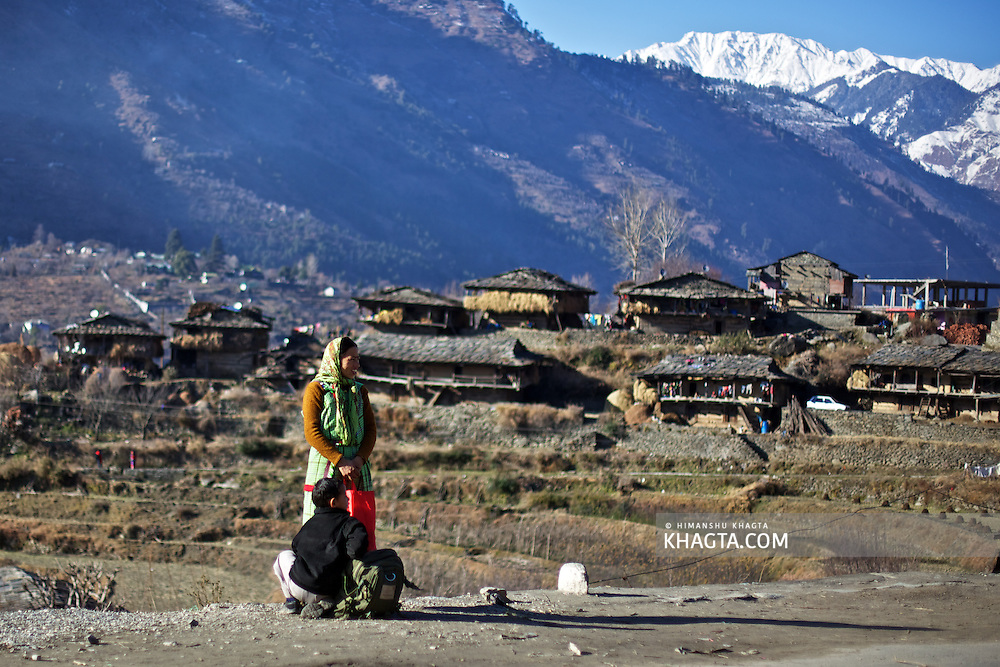 A lady from Kullu waiting for a Bus to Manali with her son at Kais Village, Kullu