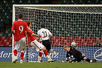 Photo: Rich Eaton.<br /> <br /> Wales v Germany. UEFA European Championships Qualifying. 08/09/2007. Germany's Miroslav Klose #11 scorers past Wales keeper Wayne Hennessey.