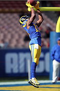Los Angeles Rams rookie wide receiver Pharoh Cooper (10) jumps and catches a pregame pass while warming up before the 2016 NFL week 16 regular season football game against the San Francisco 49ers on Saturday, Dec. 24, 2016 in Los Angeles. The 49ers won the game 22-21. (©Paul Anthony Spinelli)