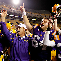 November 13, 2010; Baton Rouge, LA, USA; LSU Tigers head coach Les Miles sings with players following a win over the Louisiana Monroe Warhawks at Tiger Stadium. LSU defeated Louisiana-Monroe 51-0.  Mandatory Credit: Derick E. Hingle