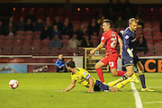 York City forward, on loan from Oldham Athletic, Rhys Turner nips past Oxford United goalkeeper Sam Slocombe  to score during the Sky Bet League 2 match between York City and Oxford United at Bootham Crescent, York, England on 29 September 2015. Photo by Simon Davies.